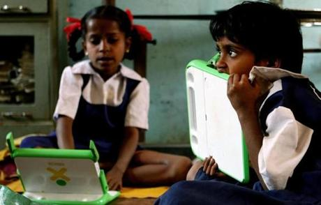 Children worked on One Laptop Per Child devices at a school in India. About 2.8 million laptops have been distributed.